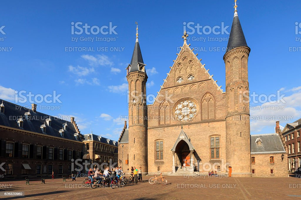 tourists by bike in front the Knights' Hall stock photo