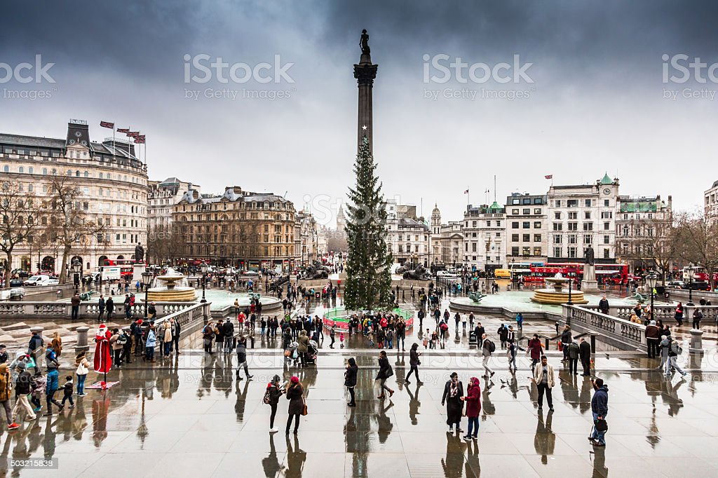 Tourists by the Christmas Tree in Trafalgar Square, London, UK stock photo