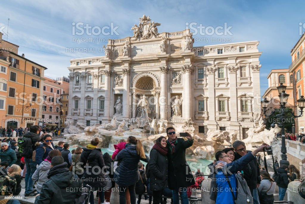 Tourists by the Trevi fountain in Rome, Italy stock photo