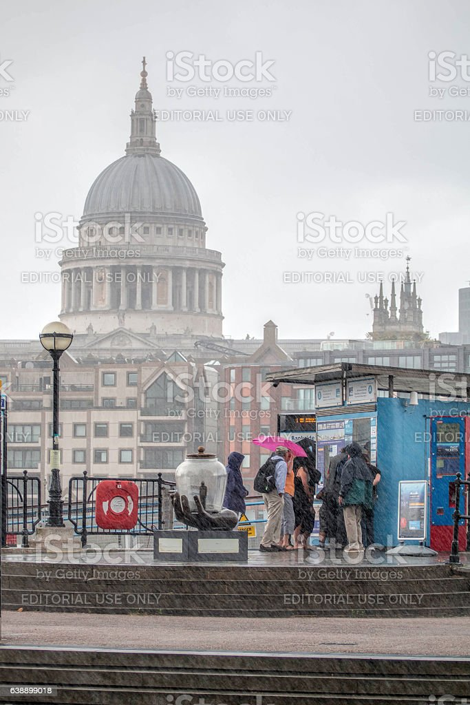 Tourists Caught In Heavy Rain By Thames, London stock photo
