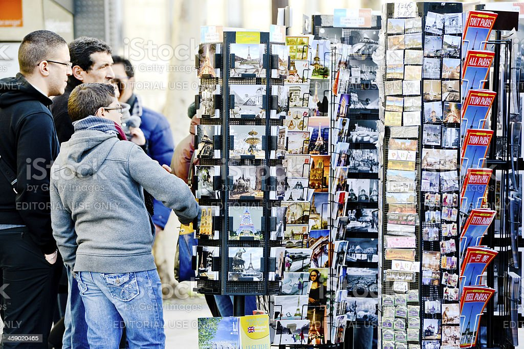 Tourists choosing postcards in a gift shop, Paris, France royalty-free stock photo