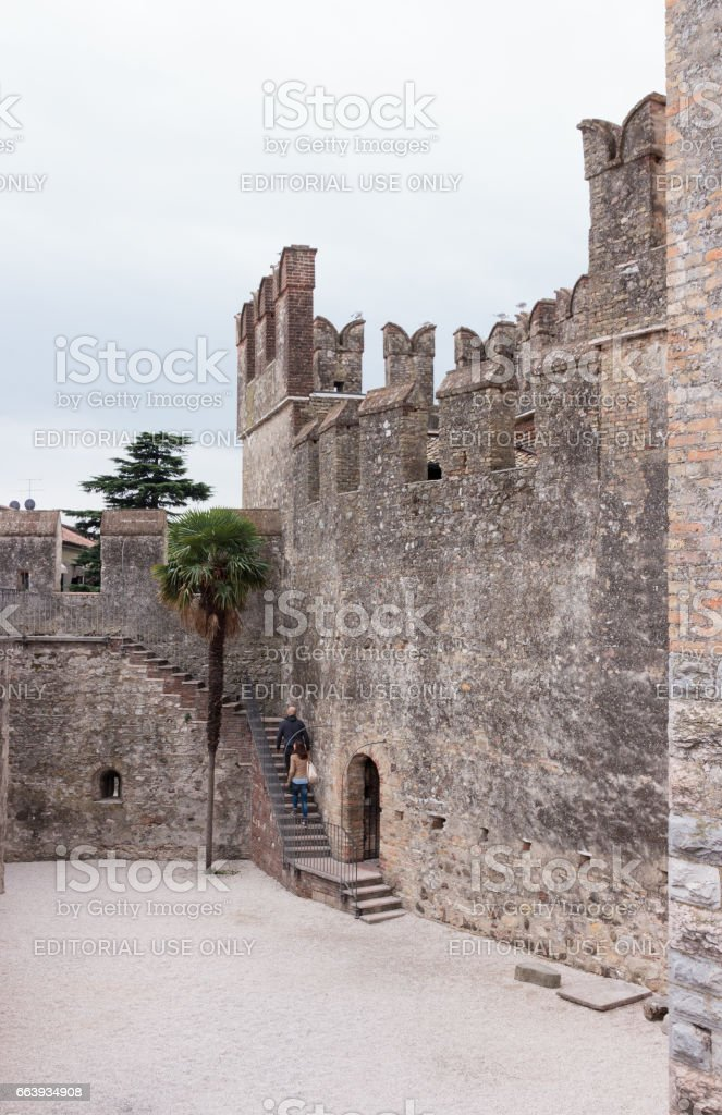Tourists climb  to the Castello Scaligero wall in Sirmione stock photo
