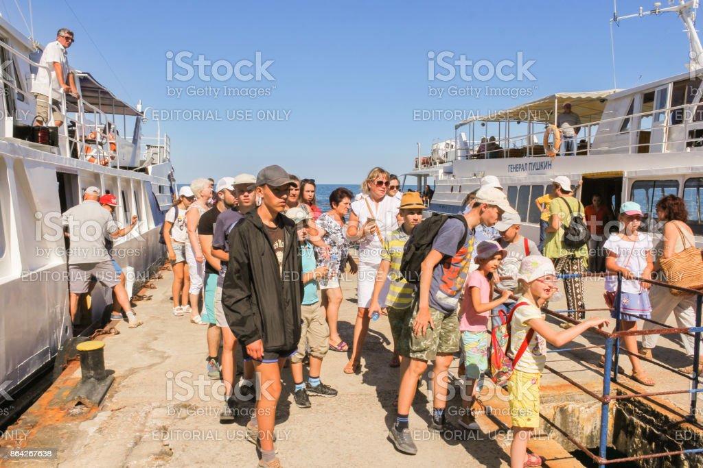 Tourists coming off the ship. royalty-free stock photo