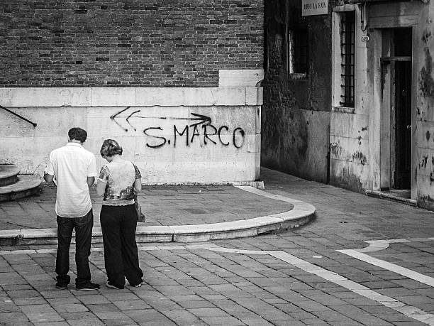 Tourists consulting a map and finding directions in Venice stock photo