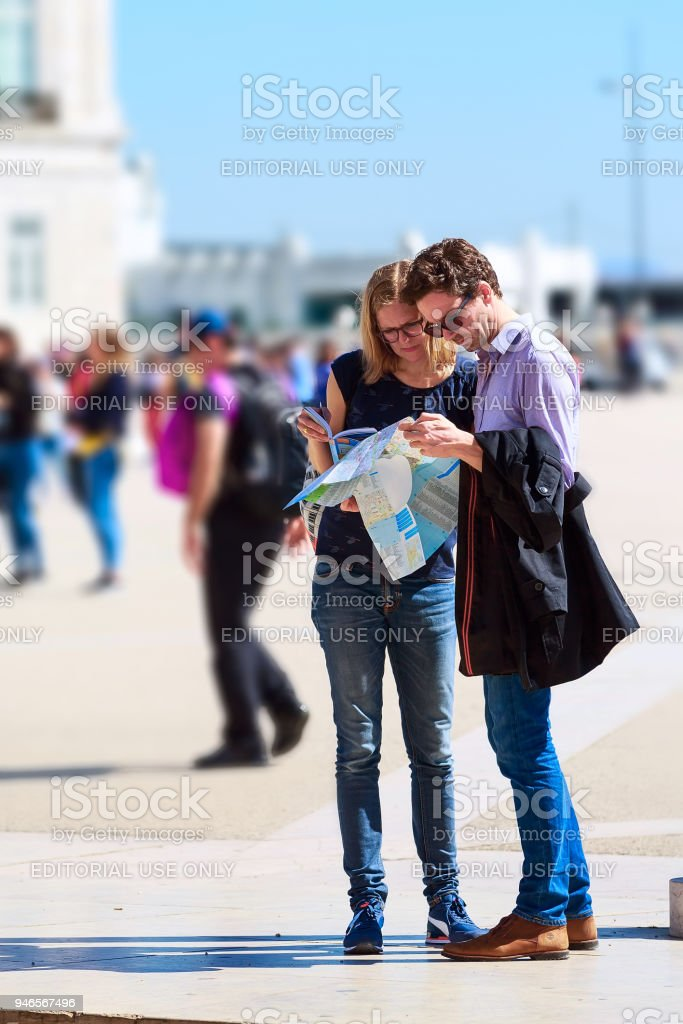 Tourists couple looking at city map stock photo