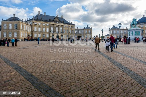 istock Tourists crowd the open court at Amalienborg Square (Queens winter residence) 1310848224