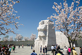 Washington, DC - April 4, 2018: Tourists crowds gather around the Martin Luther King Jr. Memorial during Cherry Blossom Festival to pay respects and view the monuments