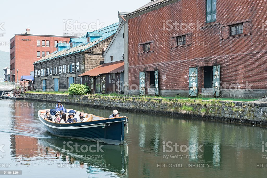 Tourists cruising on Otaru canal in the morning royalty-free stock photo