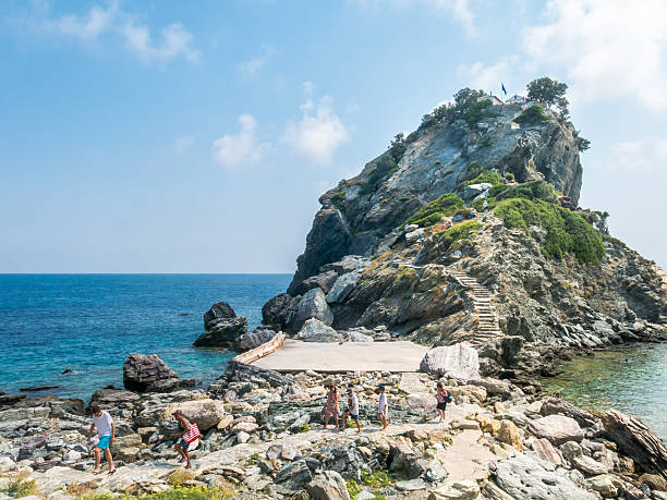 tourists descend from the remote chapel agios ioannis sto kastri - mamma mia stock photos and pictures