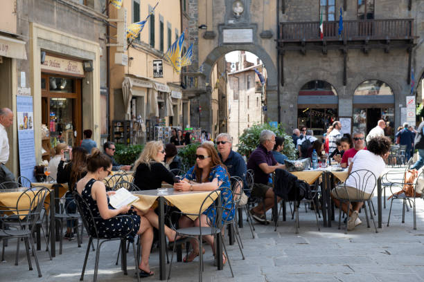 Tourists dining outdoor at town square in Cortona