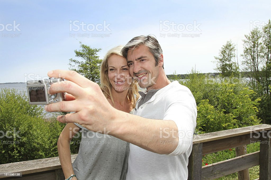 Tourists doing a photo souvenir of themselves during holidays royalty-free stock photo