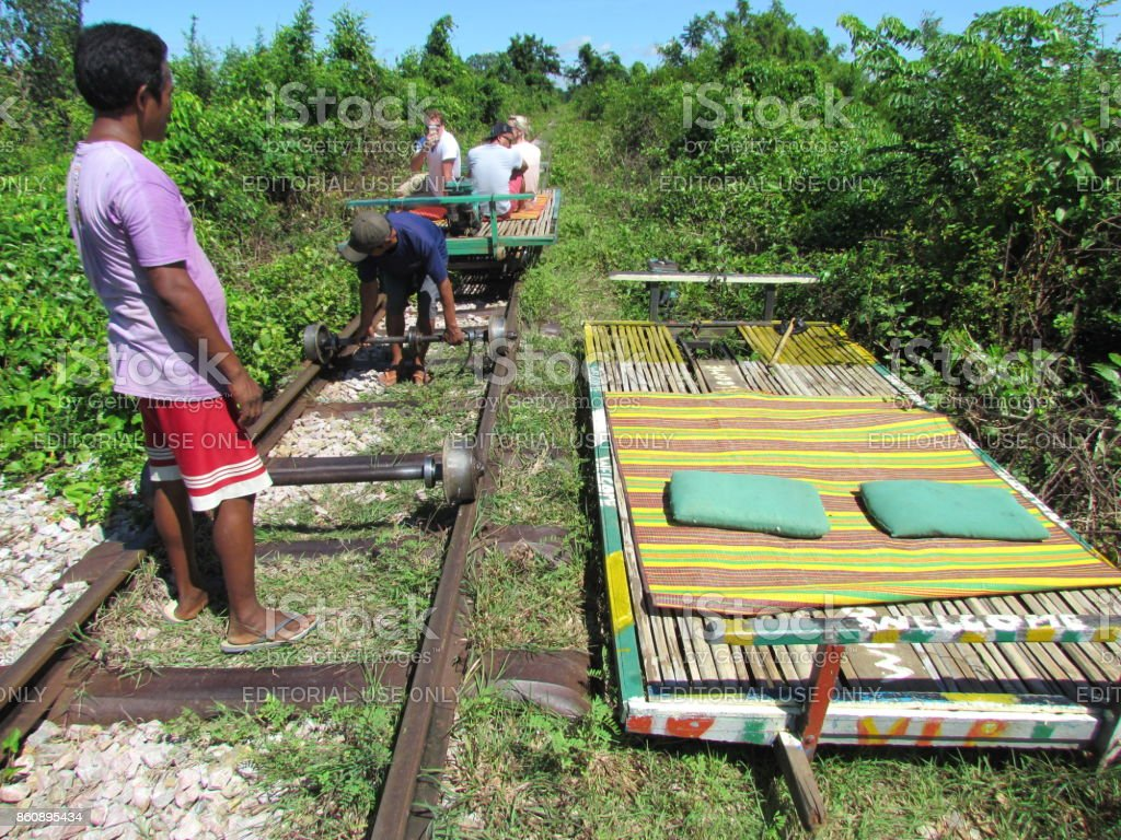 tourists doing Bamboo train in Cambodia stock photo
