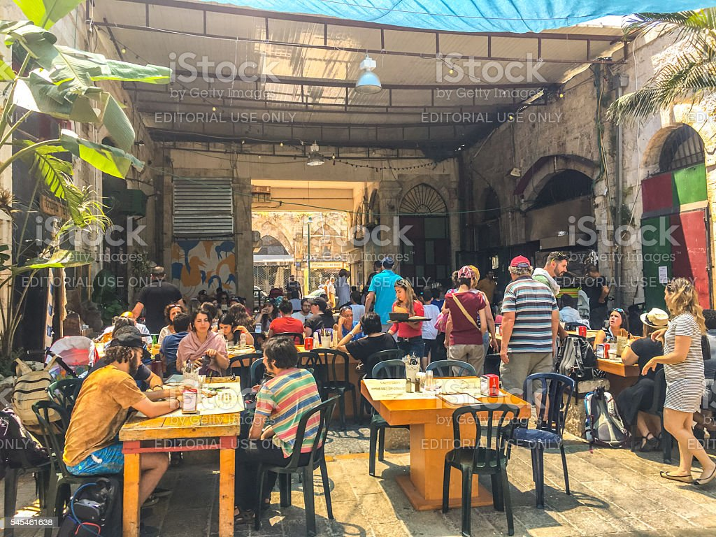 Tourists eating in outdoor cafe, Tel Aviv Yafo, Israel stock photo