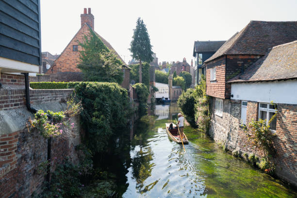 Tourists enjoy a ride in a punt on the river Stour during the Covid- 19 pandemic. stock photo