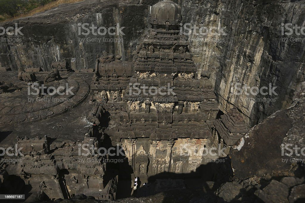 Tourists enjoy carvings at the Ellora Caves stock photo