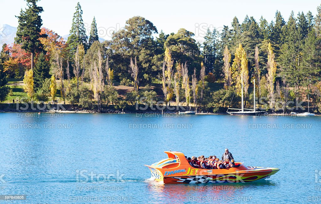Tourists enjoy a high speed jet boat ride on the Shooter River, New...
