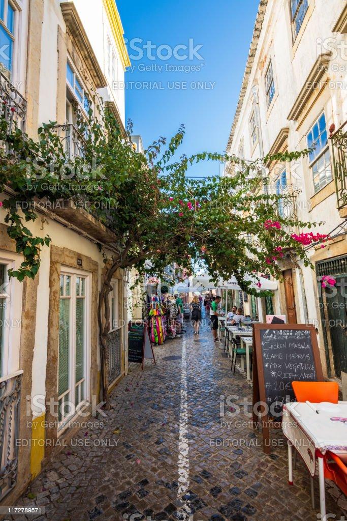 Tourists enjoy outdoor dining in Tavira, Portugal - Royalty-free Algarve Stock Photo