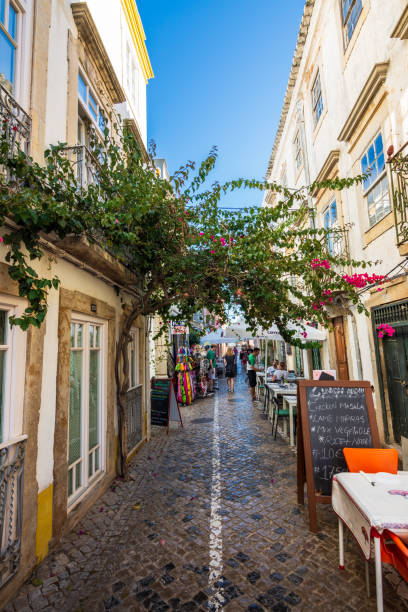 Tourists enjoy outdoor dining in Tavira, Portugal stock photo