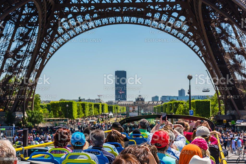 Tourists enjoy sightseeing tour on a bus in Paris stock photo