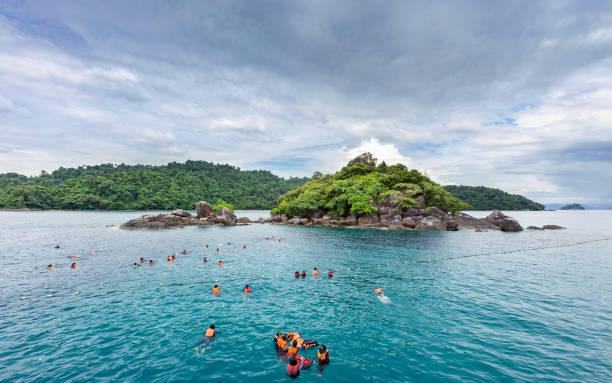Tourists enjoy snorkeling at koh chang island beautiful traveling seascape of trat province Thailand 6 December 2018, Tourists enjoy snorkeling at koh chang island beautiful traveling seascape of trat province Thailand koh chang stock pictures, royalty-free photos & images
