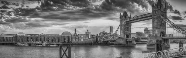LONDON - JUNE 12, 2015: Tourists enjoy the promenade along Tower Bridge. The city attracts 30 million tourists annually LONDON - JUNE 12, 2015: Tourists enjoy the promenade along Tower Bridge. The city attracts 30 million tourists annually. annually stock pictures, royalty-free photos & images