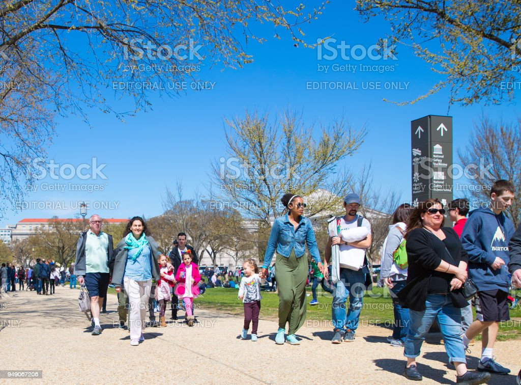 Tourists enjoy the view on the busy street stock photo