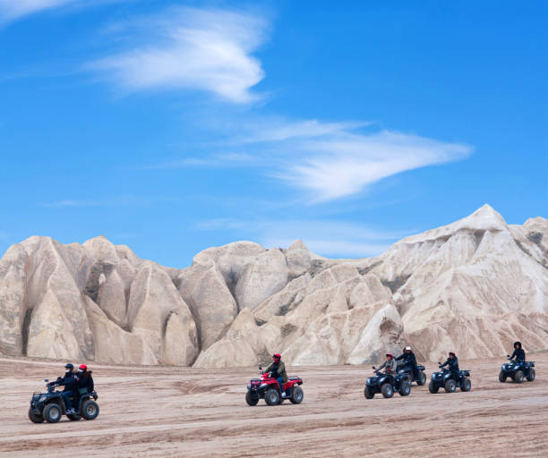 Tourists enjoying a quad bike ride in Cappadocia, Turkey stock photo