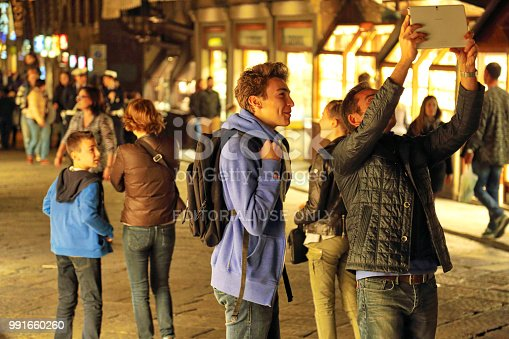 istock Tourists enjoying beautiful streets of Florence 991660260