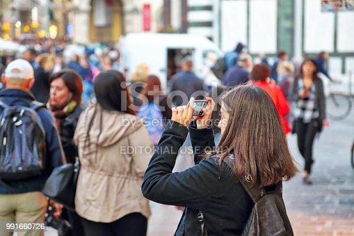 istock Tourists enjoying beautiful streets of Florence 991660726