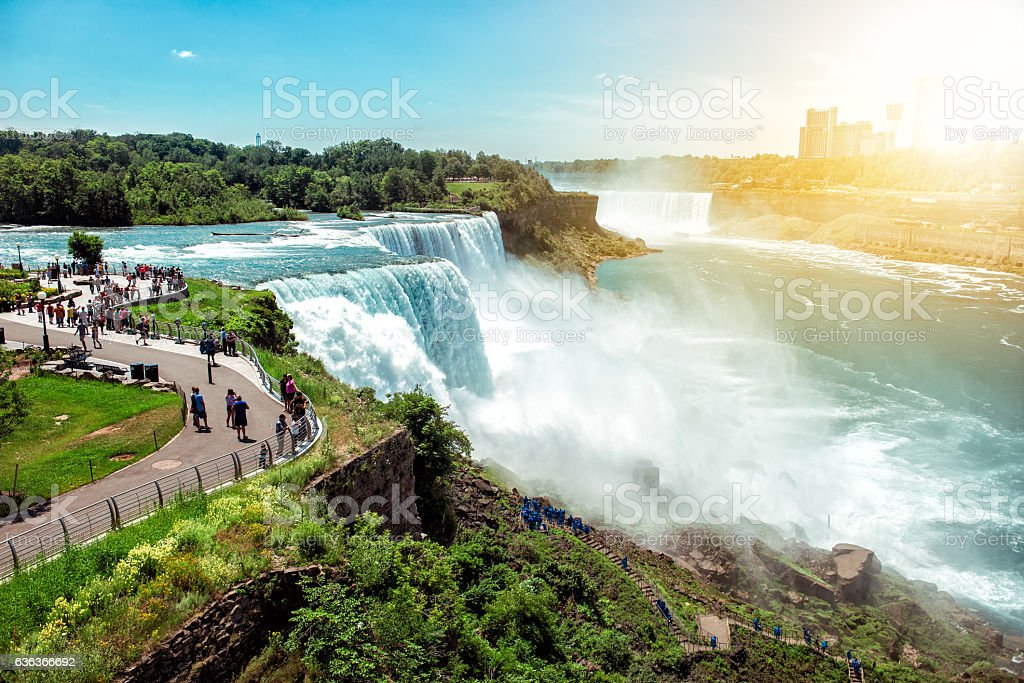 Tourists enjoying beautiful view to Niagara Falls during sunny day stock photo
