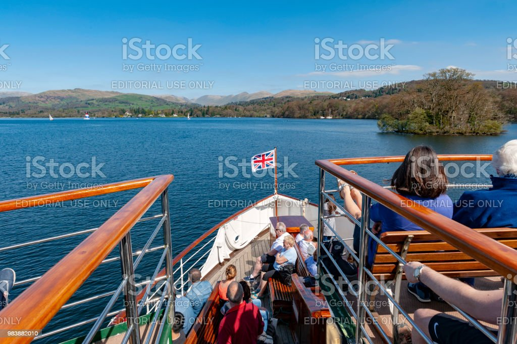 Tourists enjoying boat cruise at Lake Windermere from Bowness-on-Windermere to Ambleside on summer day in Lake District, England stock photo