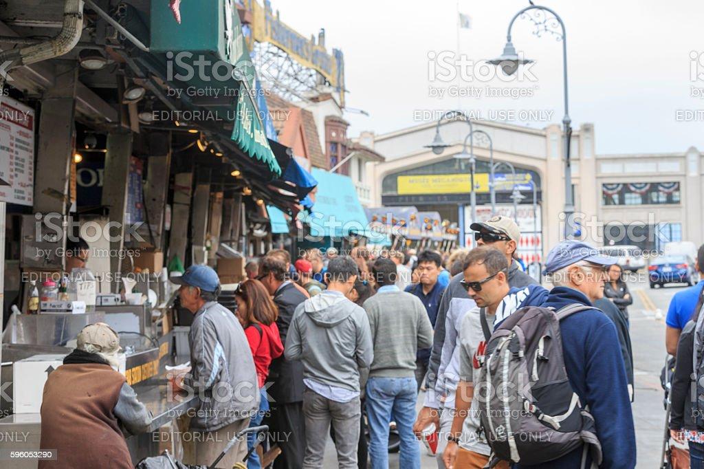 Tourists Enjoying Food at Fishermans' Wharf in San Francisco, California royalty-free stock photo