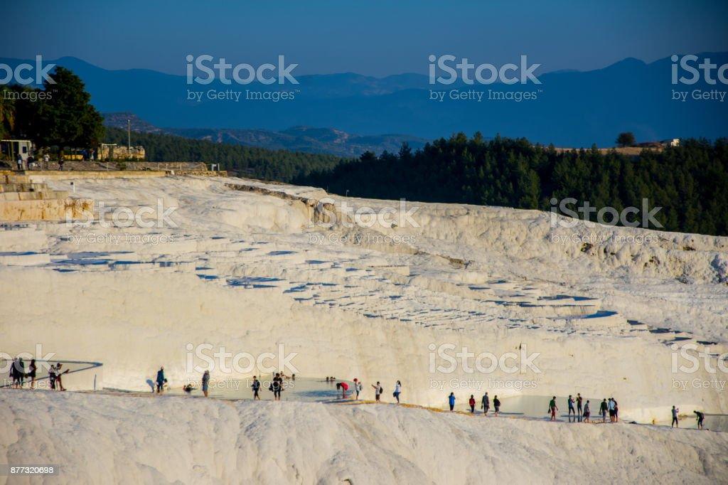 tourists enjoying in the termal water pools in Pamukkale stock photo