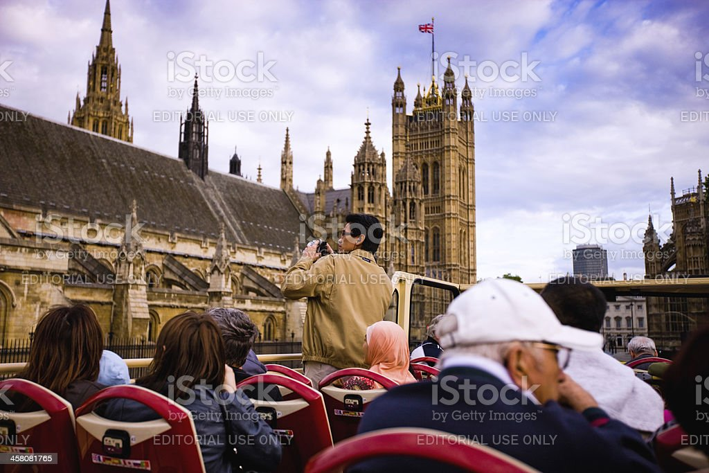 Tourists enjoying the ride on a Tour Bus in London stock photo