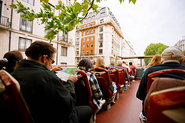 Tourists Enjoying The Ride On A Tour Bus In London Stock