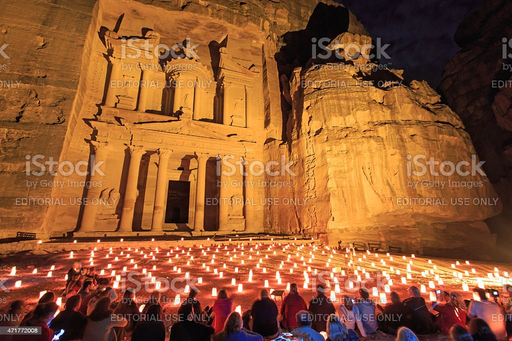 Tourists enjoying the spectacle of Petra by Night stock photo