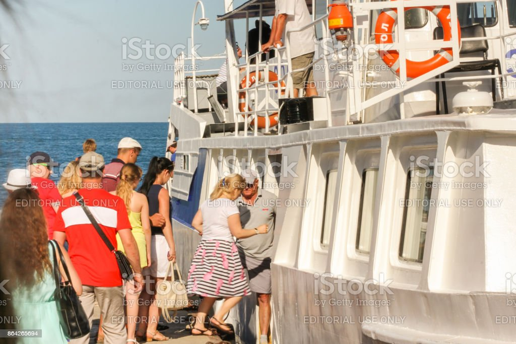 Tourists enter the ship. royalty-free stock photo