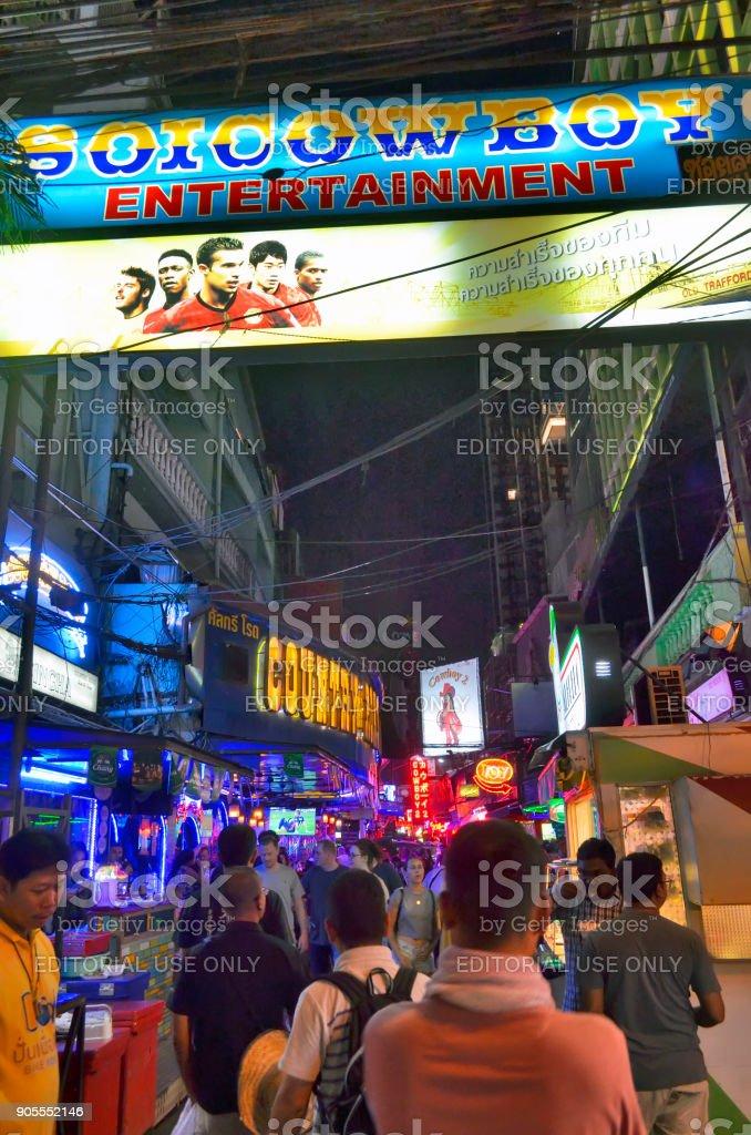 Tourists entering Soi Cowboy in Bangkok stock photo