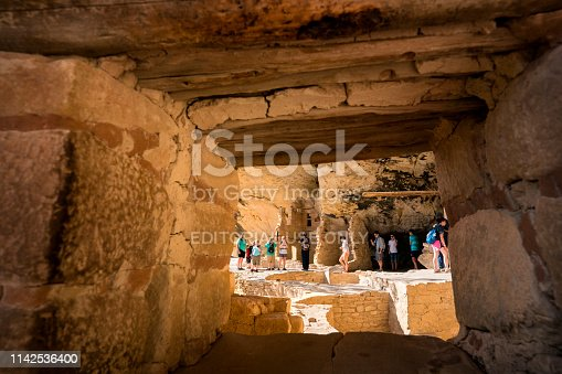 Mesa Verde, Colorado, USA - July 23, 2018: Tourists explore Balcony House ruin, an Ancient Puebloan (Anasazi) cliff dwelling that was inhabited until the 13th century, Mesa Verde National Park