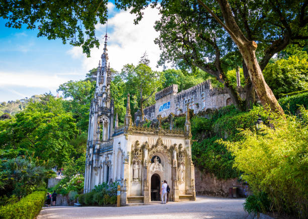 Tourists explore the Chapel of the Holy Trinity in Quinta da Regaleira in Sintra, Portugal stock photo