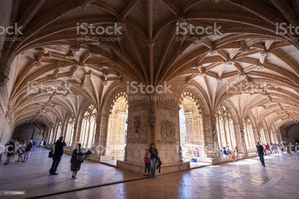 Tourists explore the cloisters of Jeronimos Monastery in Lisbon, Portugal - Royalty-free 8-9 Years Stock Photo