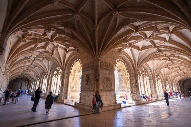 Tourists explore the cloisters of Jeronimos Monastery in Lisbon, Portugal stock photo