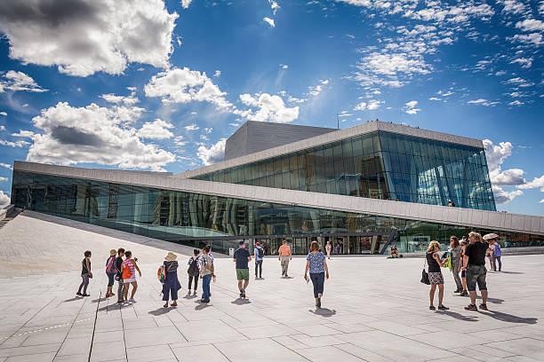 Tourists exploring Oslo Opera House, Norway stock photo