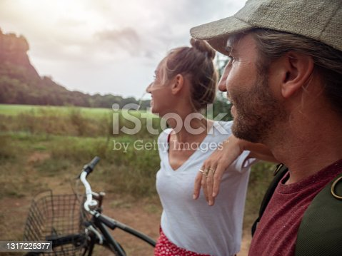 istock Tourists exploring sightseeing in Sri Lanka with bicycle 1317225377