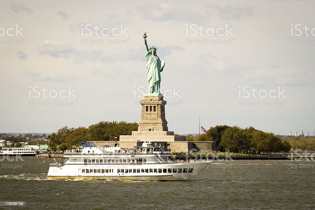 Tourists flocking to the Statue of Liberty, New York stock photo