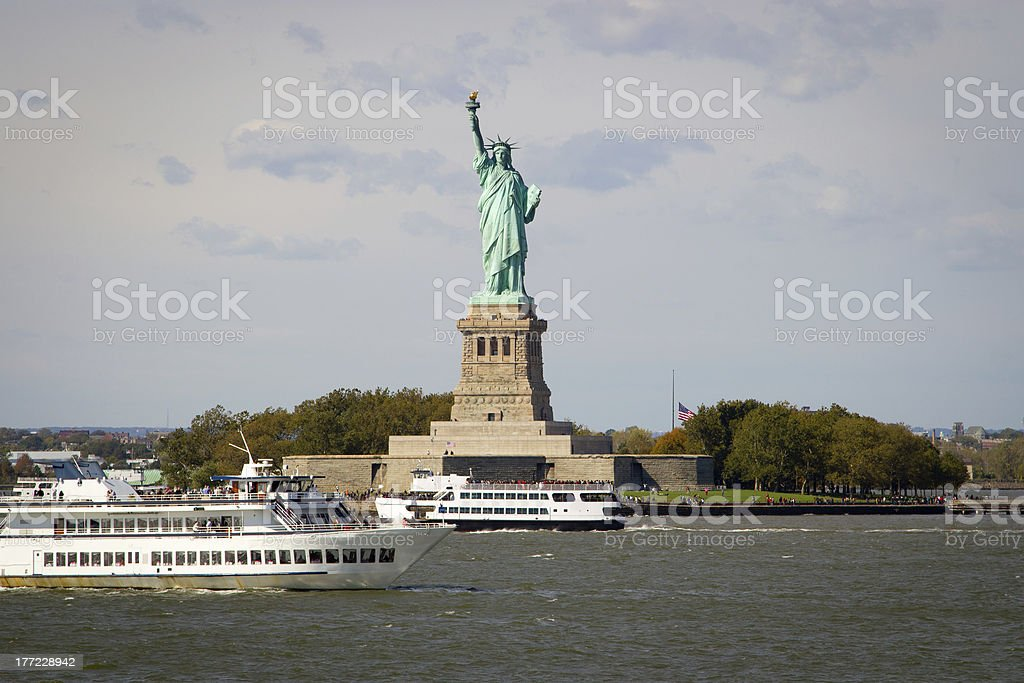 Tourists flocking to the Statue of Liberty, NY stock photo