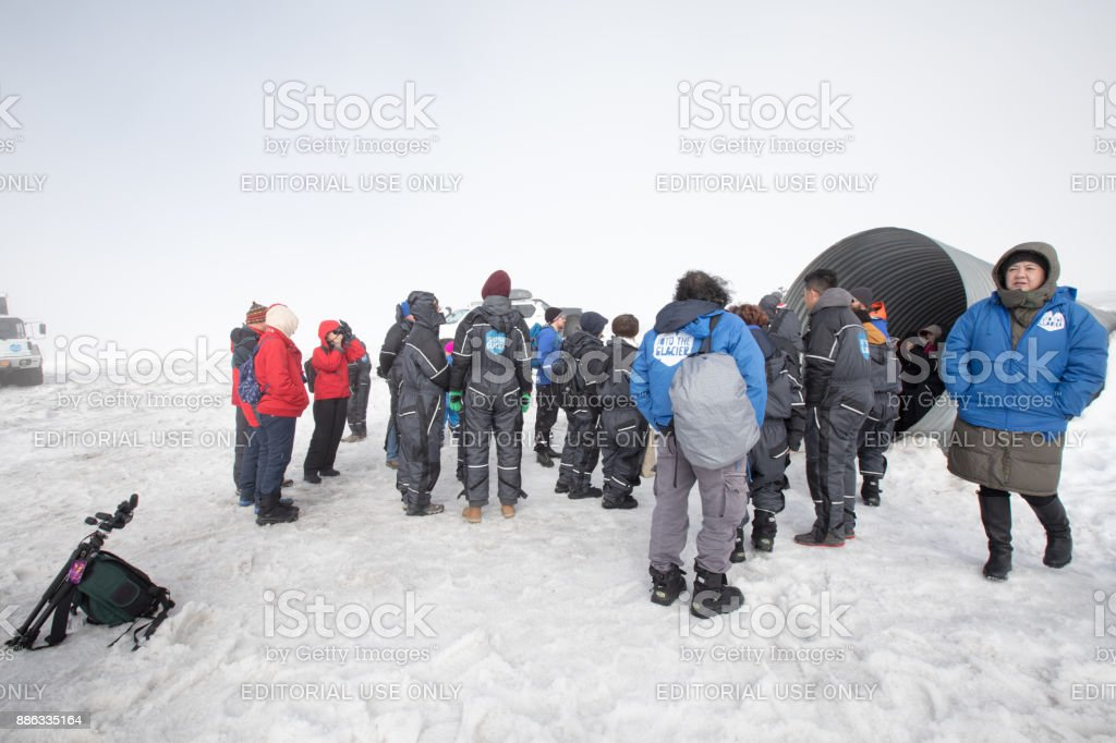 Tourists getting ready to enter the ice caves inside the Langjokull Glacier, Iceland stock photo