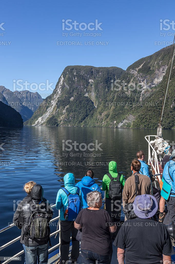Tourists Group on a Cruise at Doubtful Sound, New Zealand stock photo