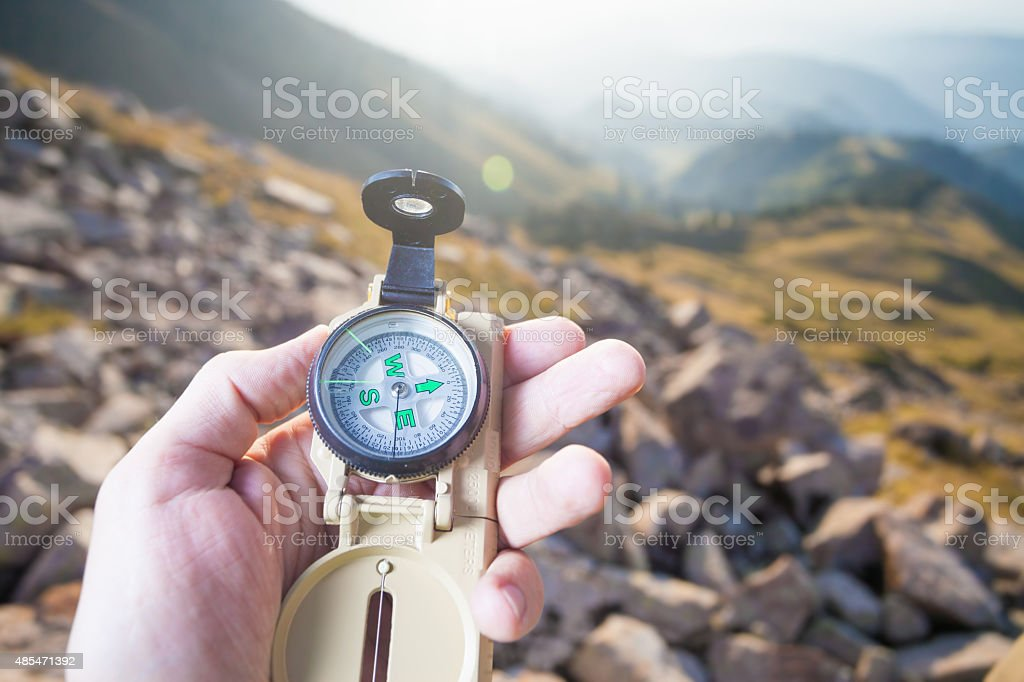 Tourist's hand with a compass in the mountain of Switzerland stock photo