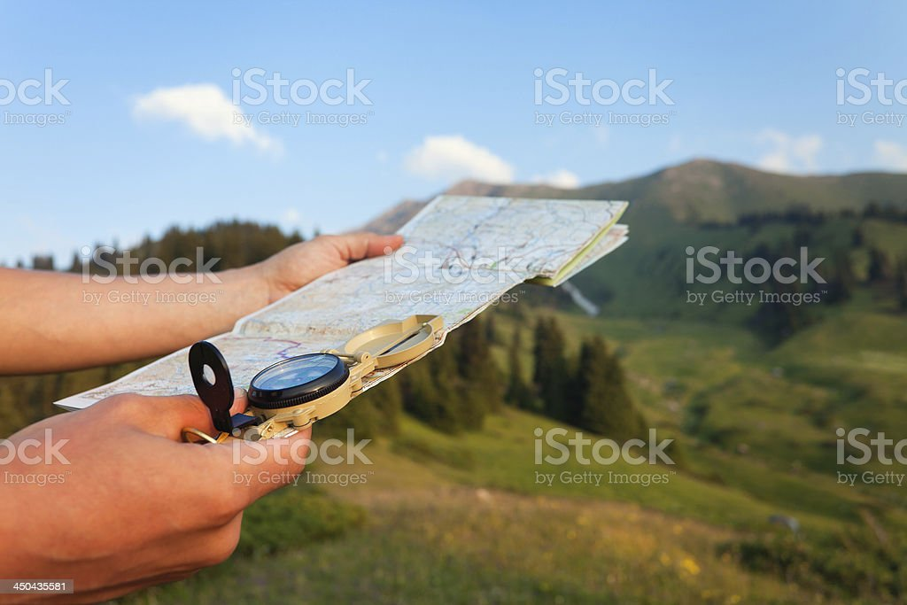 Tourist's hand with map and compass, mountains Switzerland stock photo